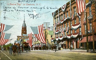 North Tryon Street decorated with flags for Mecklenburg Declaration Celebrations